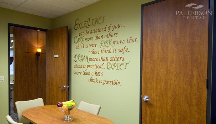 A hand-painted poem on the staff lounge wall captures Dr. Garner's vision for excellence.