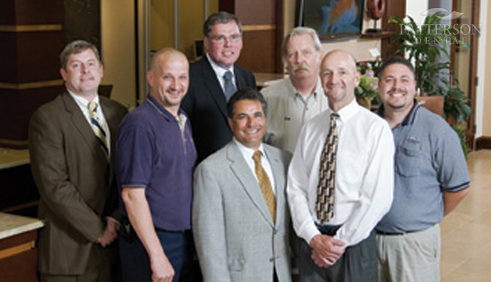 From left to right: Rex Plamann, Doug Filomena, Michael Gaurke, Jim Plescia, Ken Werderits, Dr. Dennis Collins and John Saltijeral.